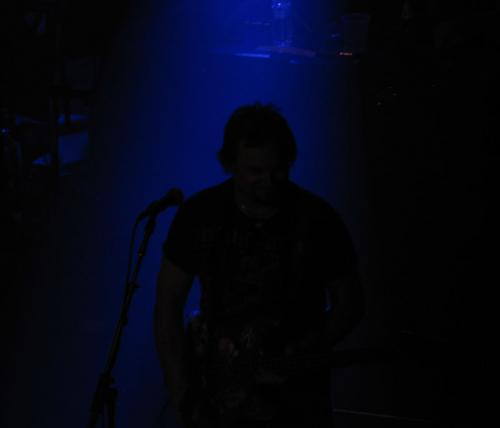 Mikey bathed in a soft blue light